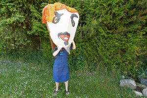 Artist at work - photo by Blair Mann, Giant puppet head by Odette Laramee